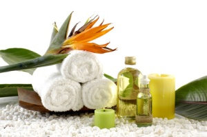 wooden bowl of towel and spring flower with massage oil